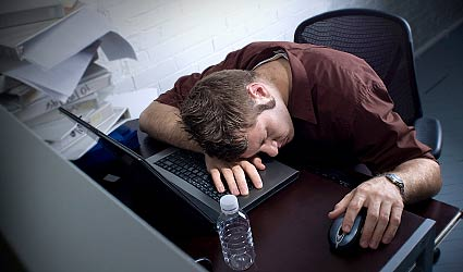 Image of guy sleeping at computer